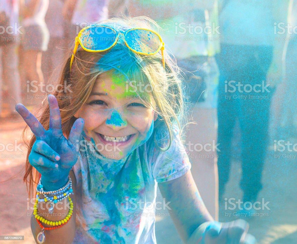 Portrait of happy litttle girl on holi color festival stock photo