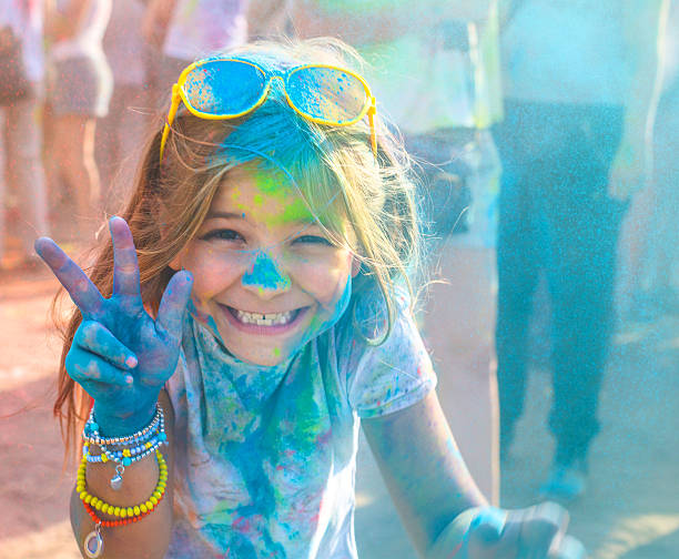 Portrait of happy litttle girl on holi color festival - Photo