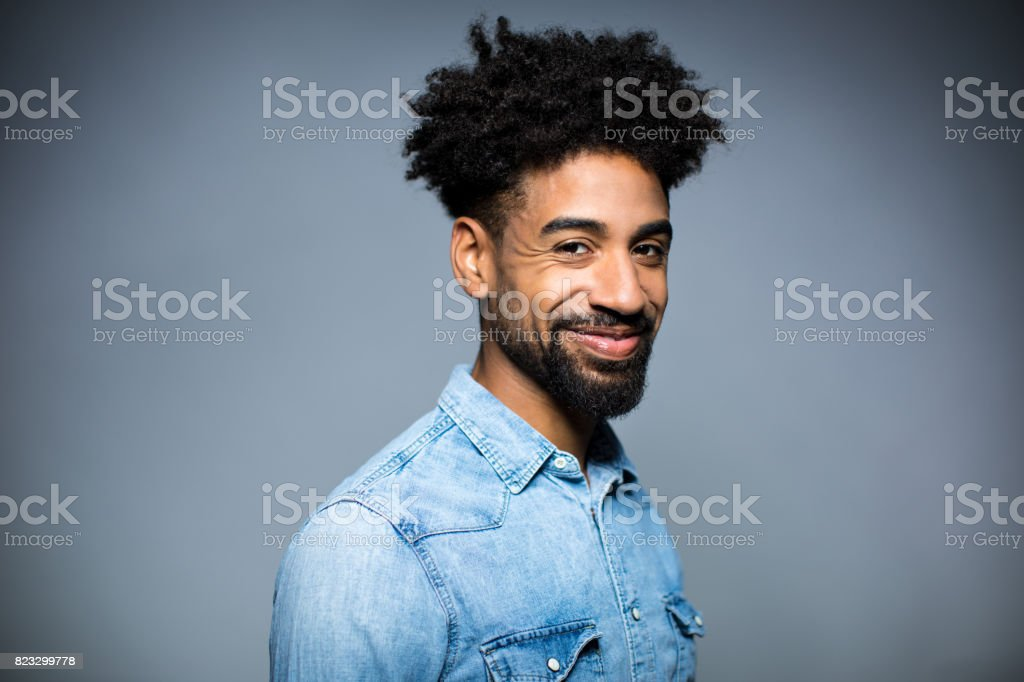 Portrait Of Happy Man Against Gray Background stock photo