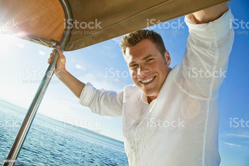 Portrait of happy man on sailboat foto stock royalty-free