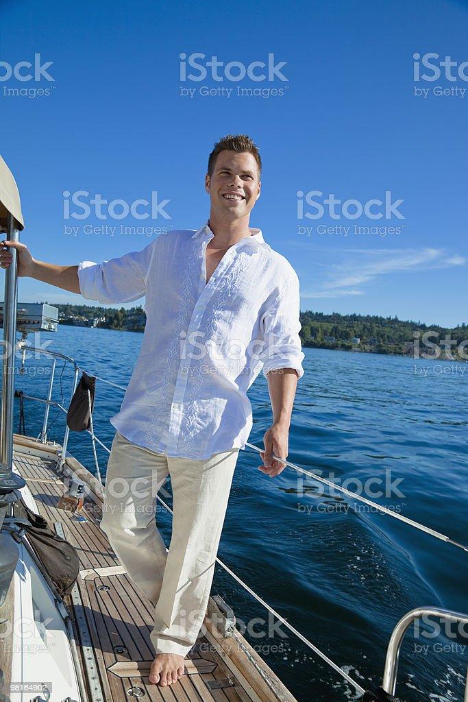 Portrait of happy man on sailboat royalty-free stock photo