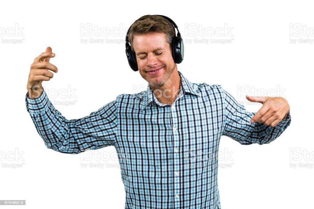 Kulaklık takmış mutlu bir adam portresi royalty-free stock photo