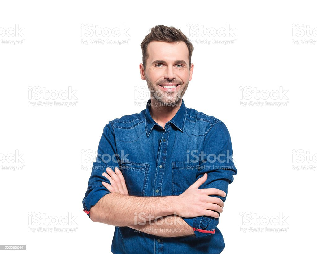 Portrait of happy man wearing jeans shirt Portrait of happy adult man wearing jeans shirt, standing against the white background with arms crossed, smiling at camera.  30-39 Years Stock Photo