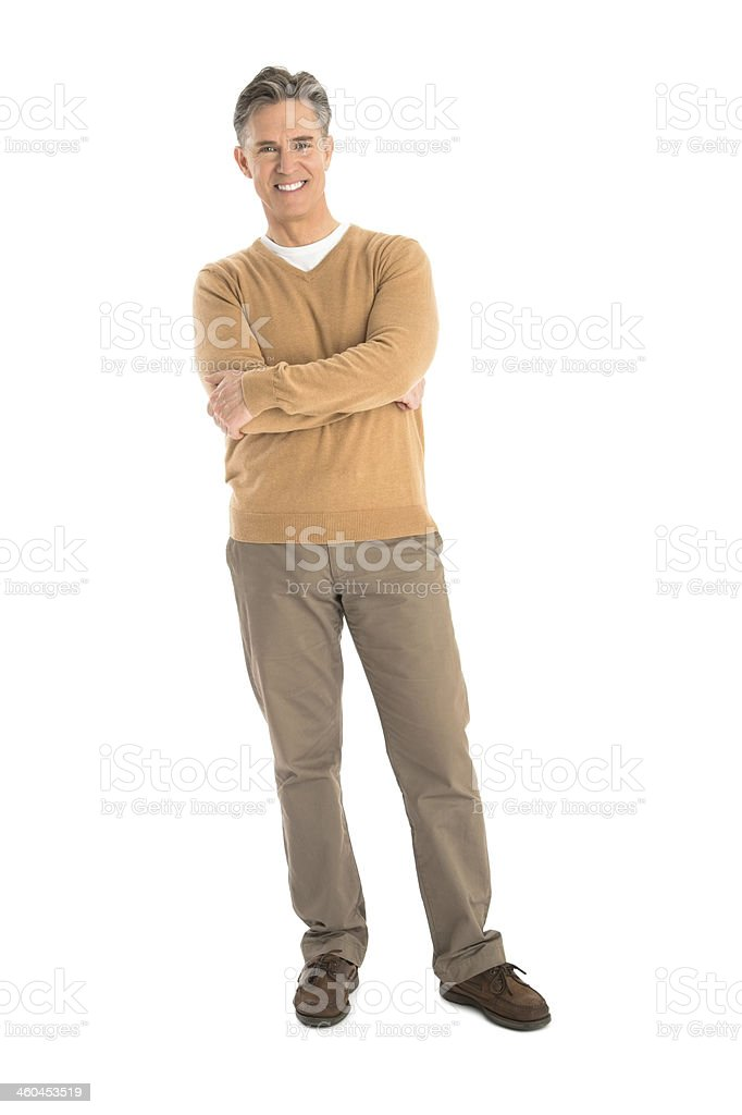 Portrait Of Happy Mature Man Standing Arms Crossed stock photo