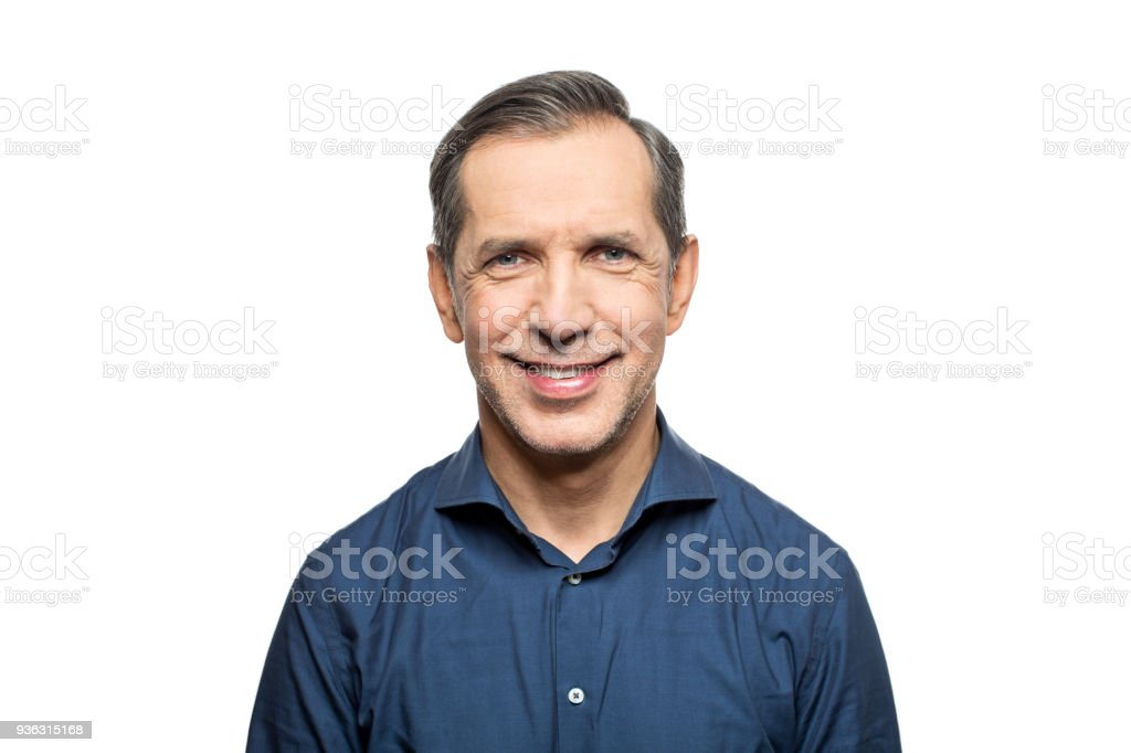 Portrait of happy mature man wearing blue shirt stock photo