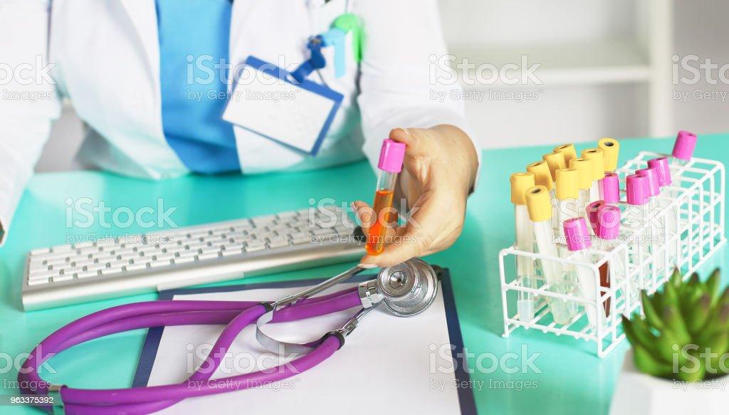 Portrait of happy medical doctor woman in office - Zbiór zdjęć royalty-free (Białoruś)