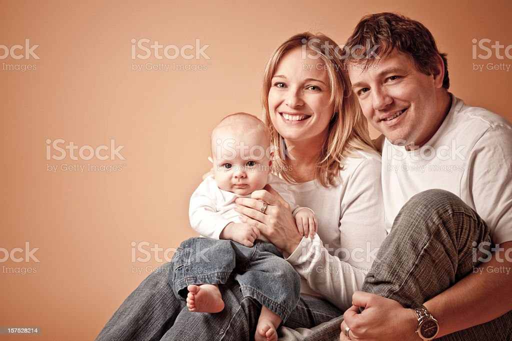 Portrait of happy mother and father with their newborn baby royalty-free stock photo