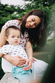istock Portrait of happy mother and son outdoors in a park 623440726