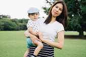 istock Portrait of happy mother and son outdoors in a park 640305164