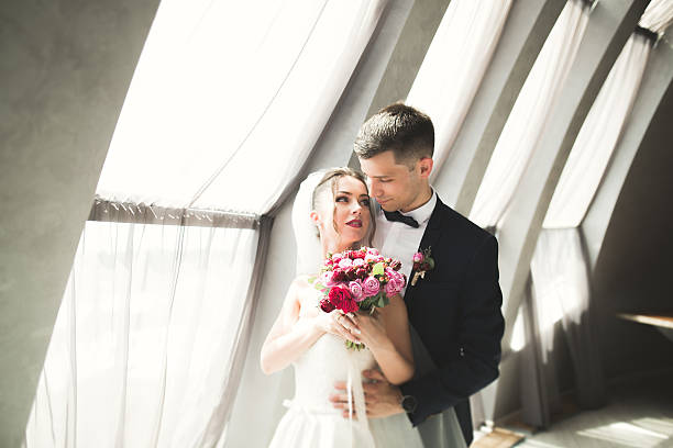 Portrait of happy newly wedding couple with bouquet stock photo