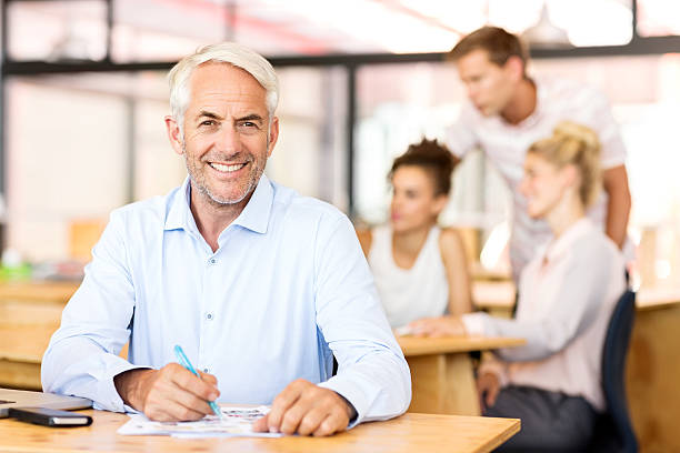 Portrait of happy office worker sitting at desk picture id497260329?b=1&k=6&m=497260329&s=612x612&w=0&h= h0r nnozmsdj5cnwp 5bhjje7psep3n 9ysfkohmhs=