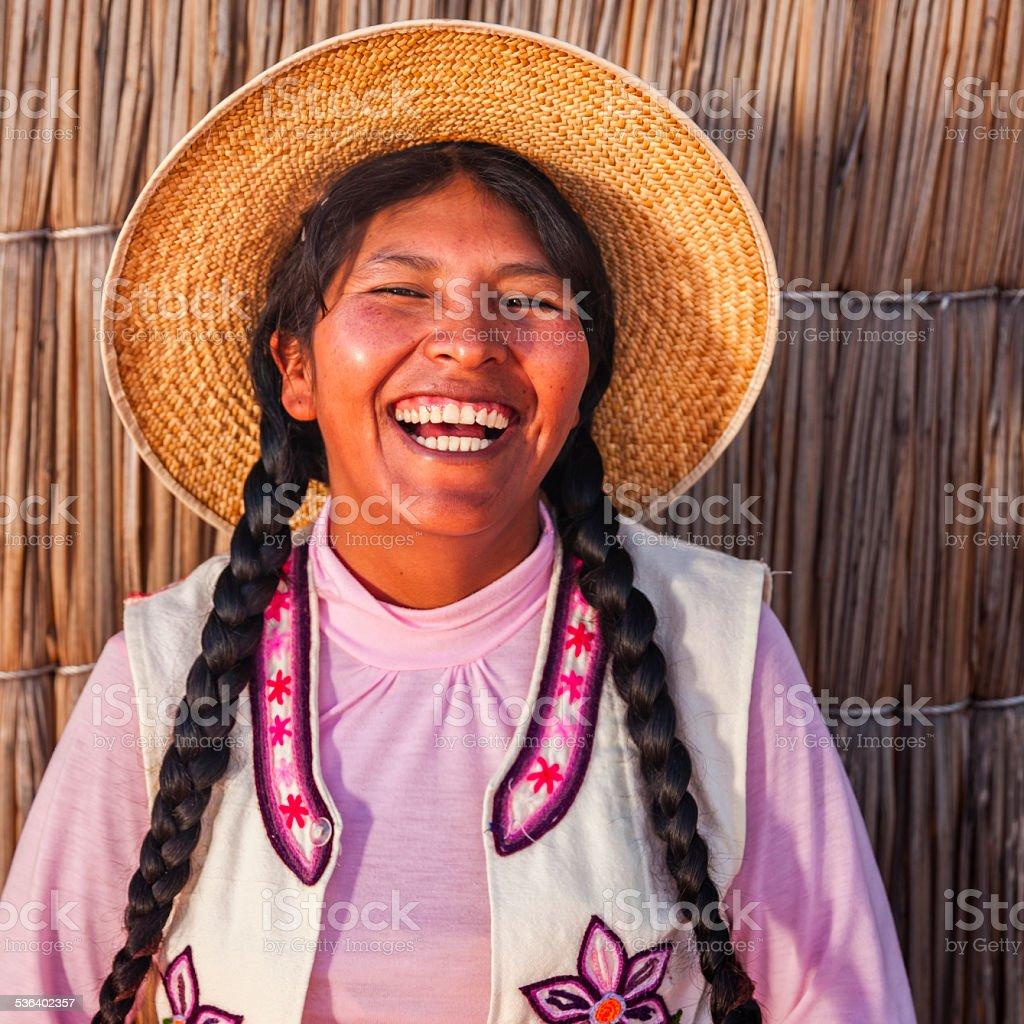 Portrait of happy peruvian woman, Uros floating island, Lake Tititcaca stock photo