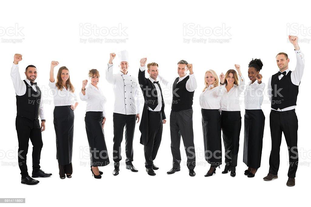 Portrait Of Happy Restaurant Staff Celebrating Success stock photo