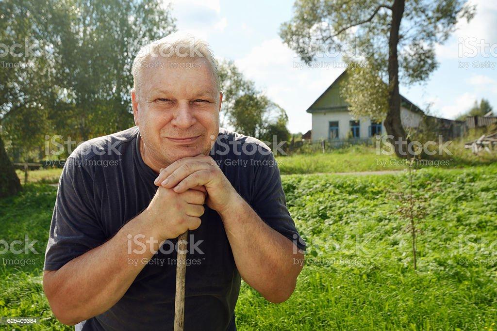 Portrait of happy rural elderly man with gray hair. stock photo