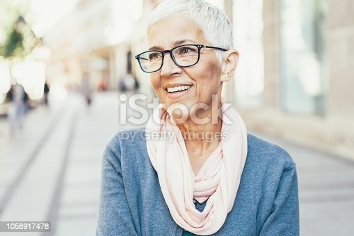 Portrait of Happy Senior Lady on the city street