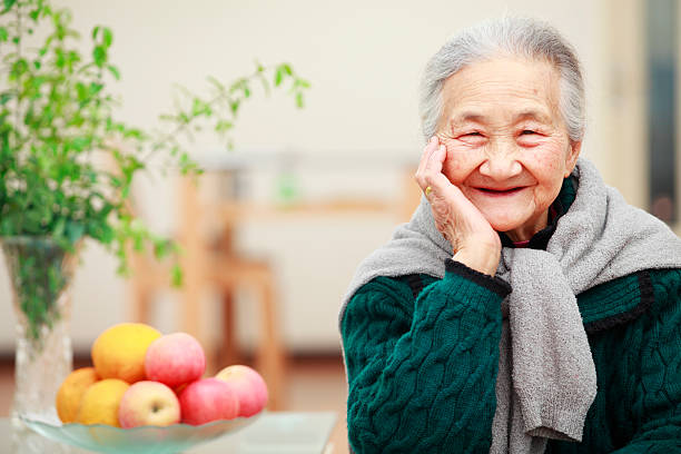 portrait of happy senior woman picture of happy senior asian woman in home 80 89 years stock pictures, royalty-free photos & images