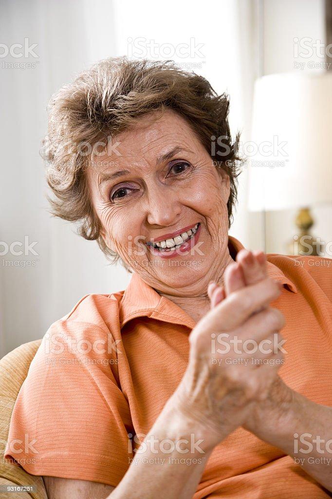 Portrait of happy senior woman smiling royalty-free stock photo