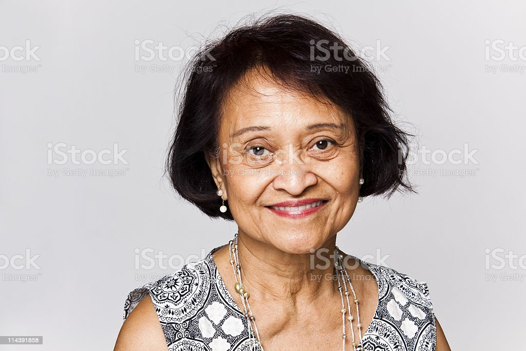 Portrait of happy senior woman with short brown hair stock photo
