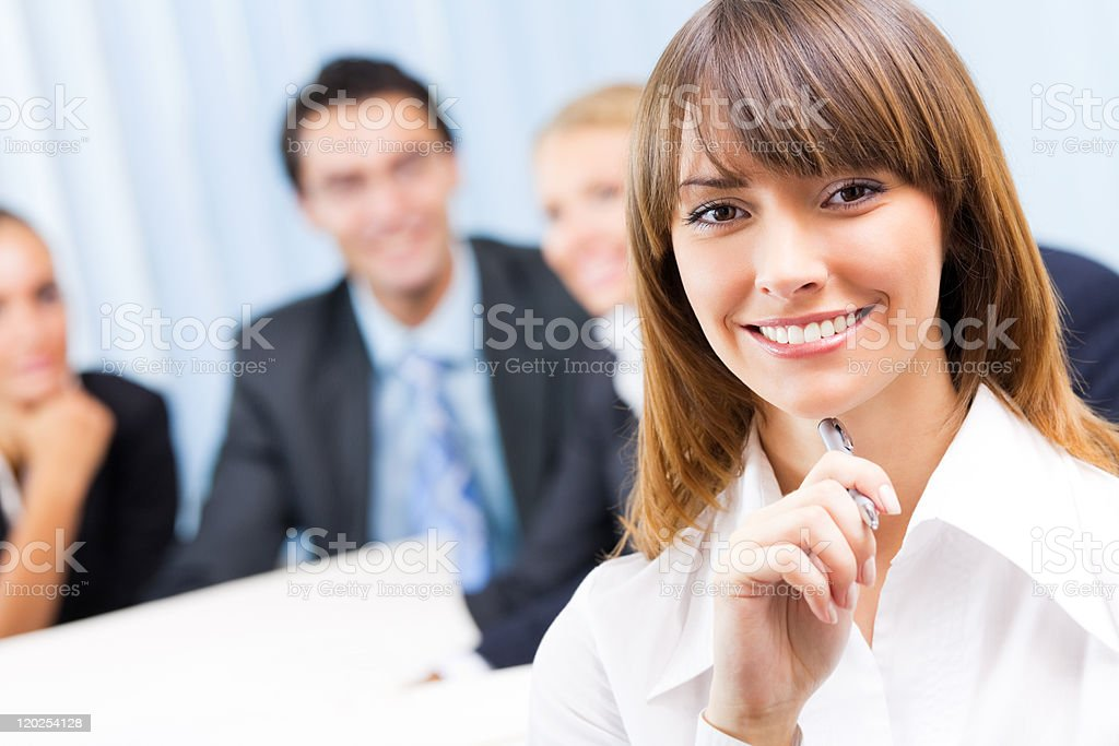 Portrait of happy smiling businesswoman and colleagues at office stock photo