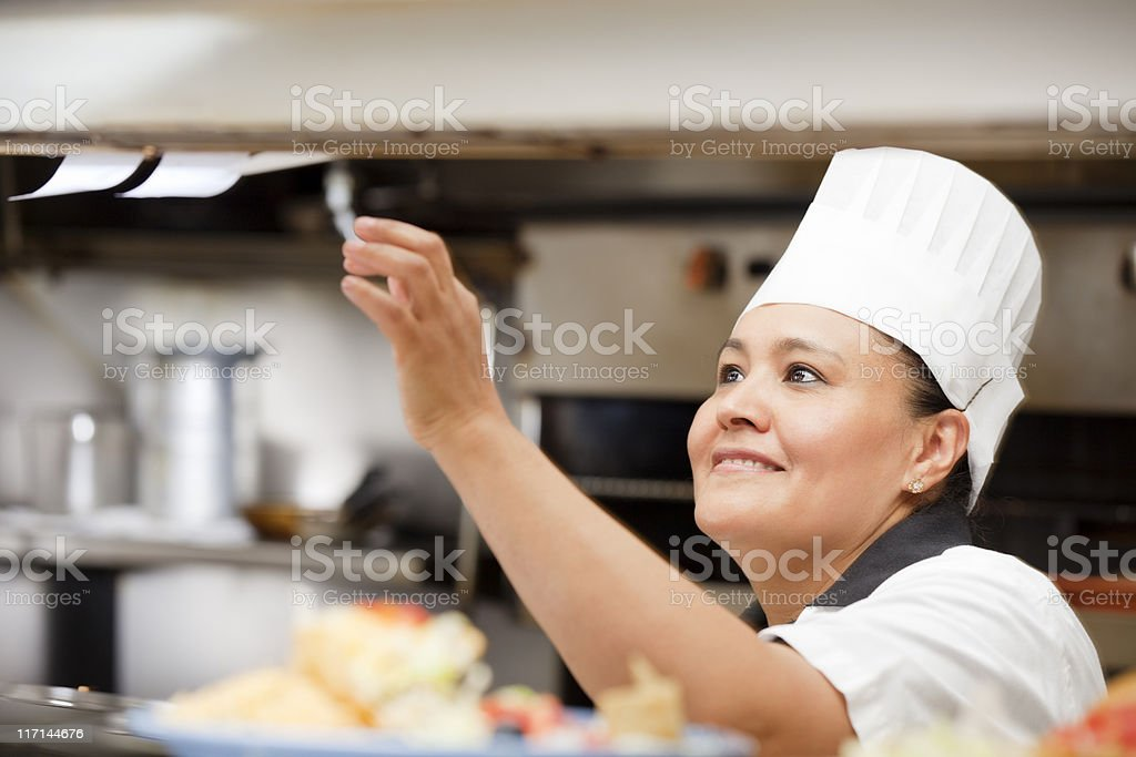 Portrait of happy smiling cook inside the restaurant kitchen stock photo