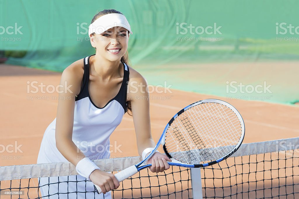 Portrait of Happy Smiling Female Tennis Player at Court stock photo
