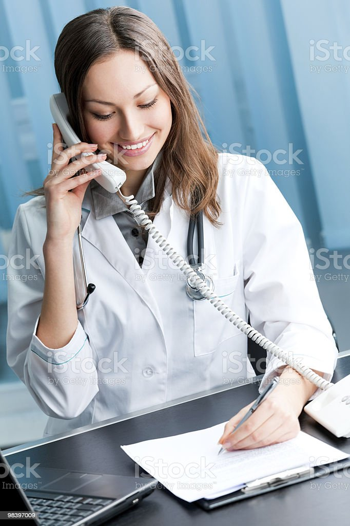 Portrait of happy successful doctor on phone at office royalty-free stock photo