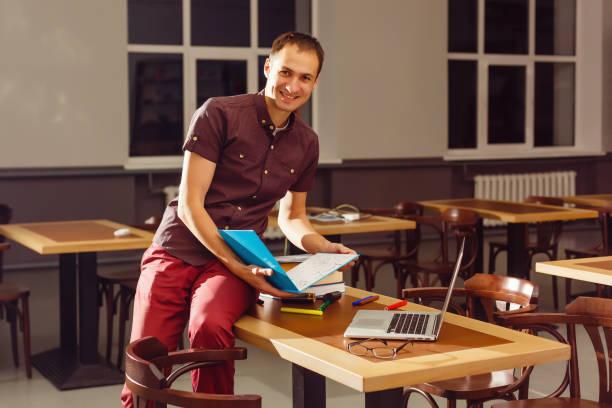 Portrait of happy teacher in classroom picture id1127616487?b=1&k=6&m=1127616487&s=612x612&w=0&h=4wp4pxquhstrfglpdpf7wfh1hm txeupbvcvptynyxm=
