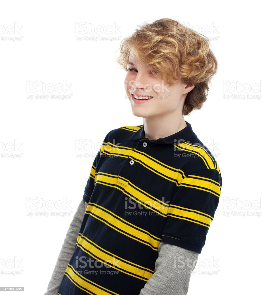 Portrait of   happy  teenage boy  looking away. White background. royalty-free stock photo