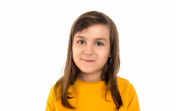 Portrait of happy teenage girl looking at camera with smiling facial expression over white background stock photo