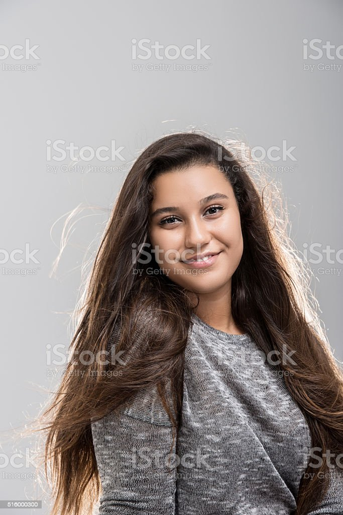 Portrait of happy teenage girl stock photo