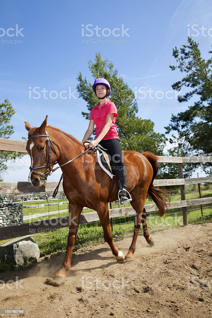 Portrait of happy teenager riding a horse royalty-free stock photo