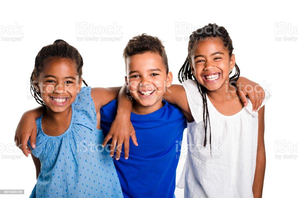 portrait of happy three black childrens, white background stock photo