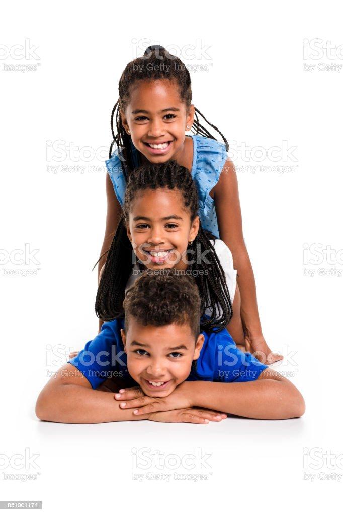 retrato de feliz fundo preto para três crianças, branco - foto de acervo