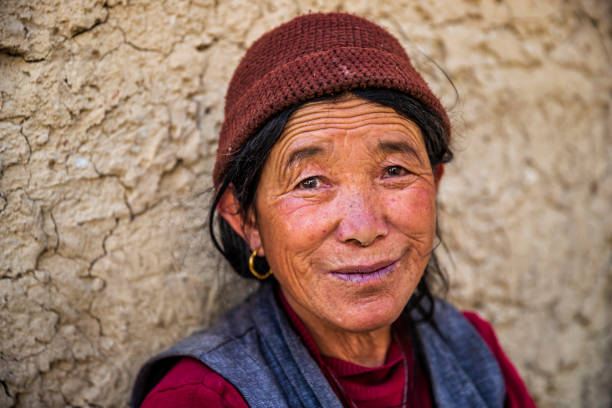 Portrait of happy Tibetan woman, Upper Mustang, Nepal stock photo