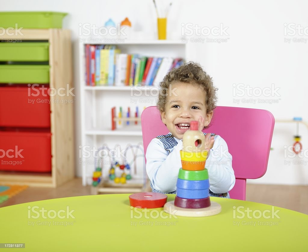 Portrait Of Happy Toddler Playing With Multi-Coloured Rings royalty-free stock photo