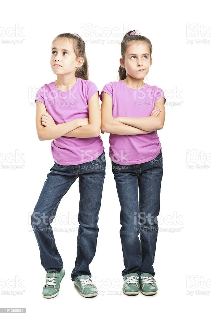 portrait of happy twins stock photo