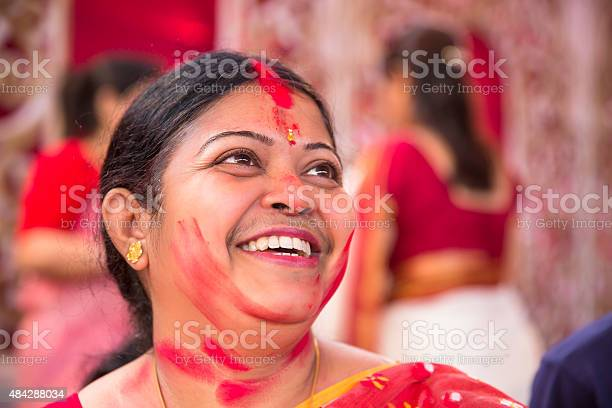 Portrait of happy woman after applying vermilion during durga puja picture id484288034?b=1&k=6&m=484288034&s=612x612&h=8q22torytllaqeil79hml9 aatmcqobzqywnelibzho=