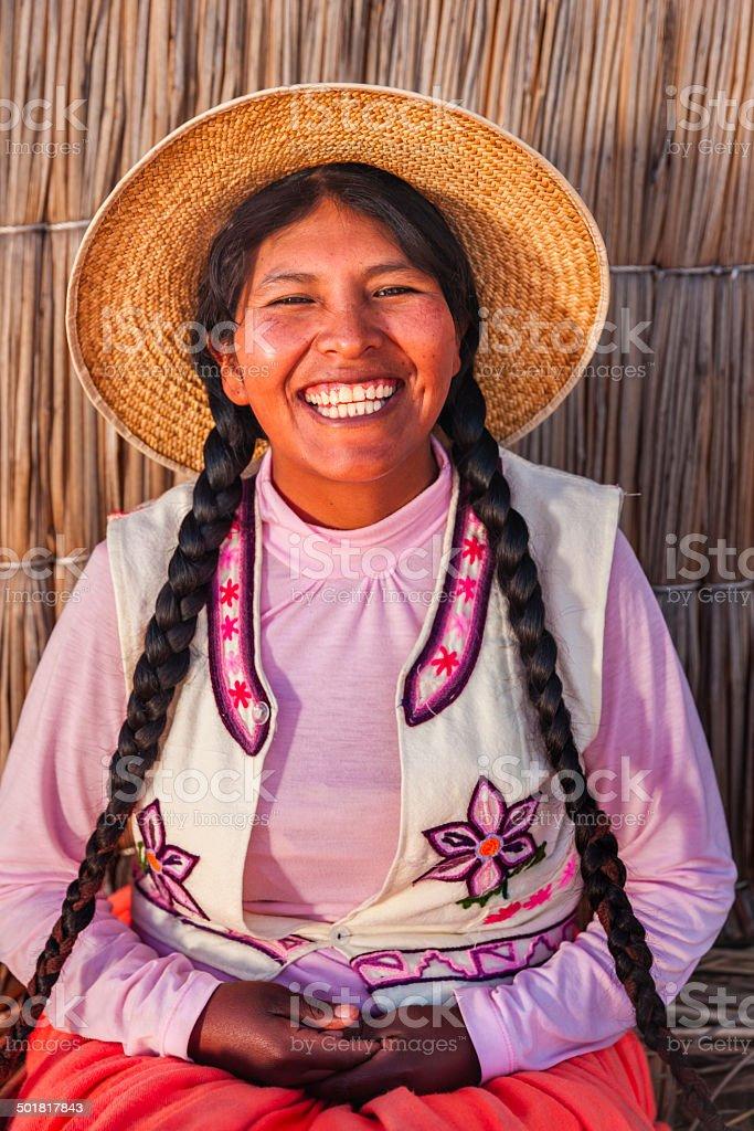 Portrait of happy woman on Uros floating island, Lake Tititcaca stock photo