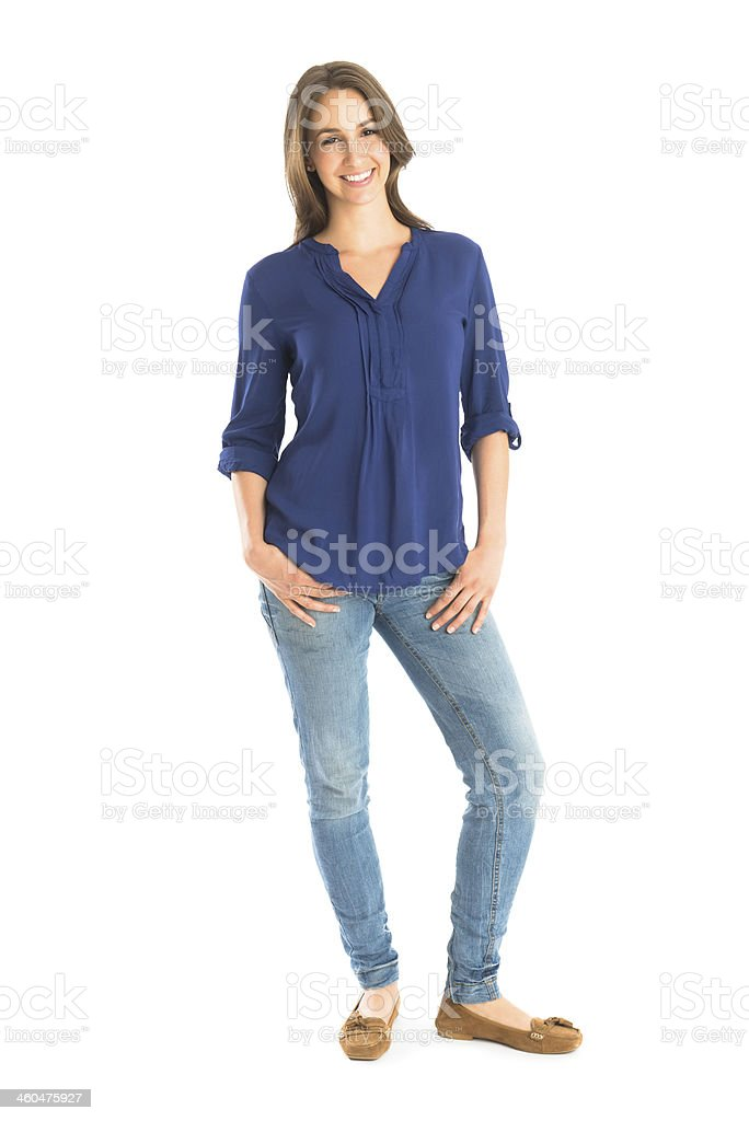 Portrait Of Happy Woman Standing With Hands In Pockets stock photo