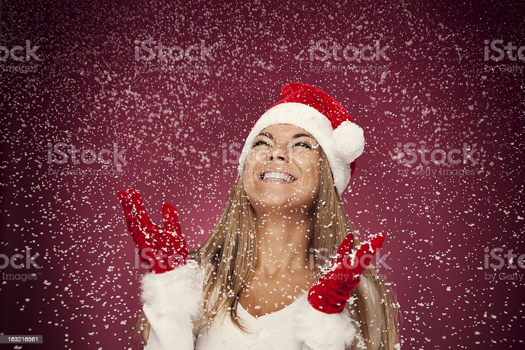 Portrait of happy woman with snowflakes stock photo