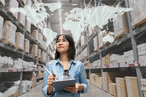 613881746 istock photo Portrait of happy young attractive asian entrepreneur woman looking at inventory in warehouse using smart tablet in management technology,  interconnected industry, asian small business sme concept. 1145150074