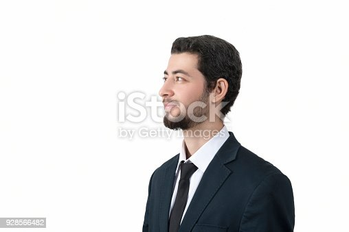 istock Portrait of happy young businessman looking away by smiling over white background 928566482