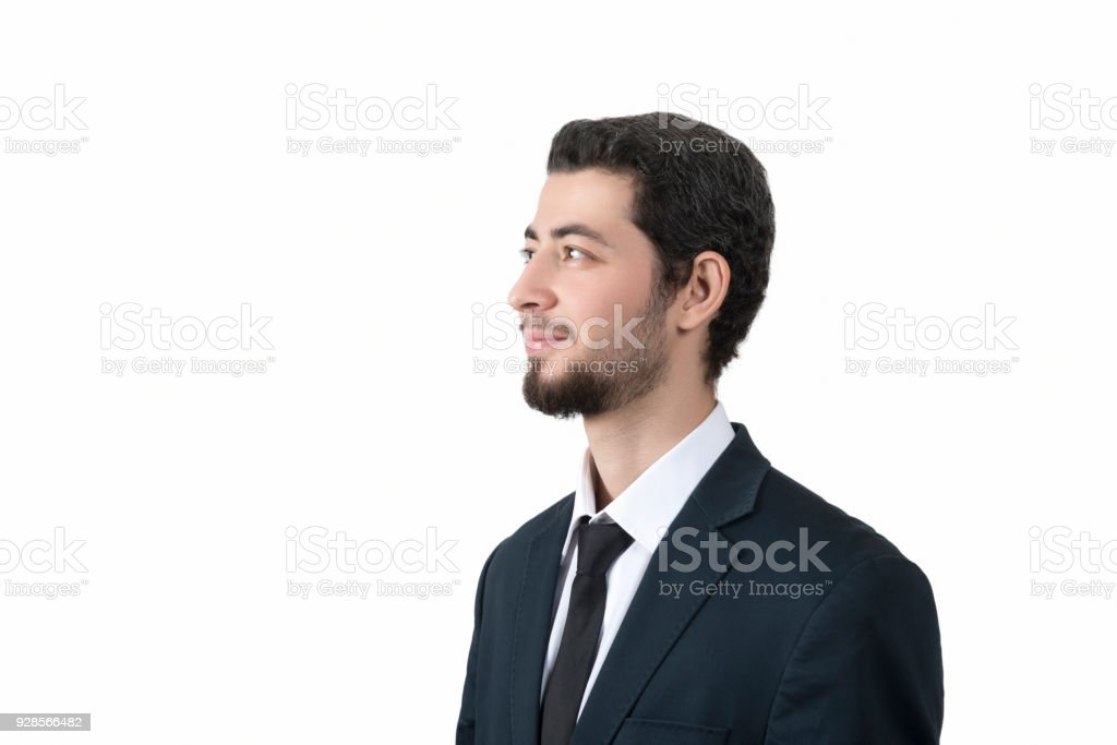 Portrait of happy young businessman looking away by smiling over white background stock photo