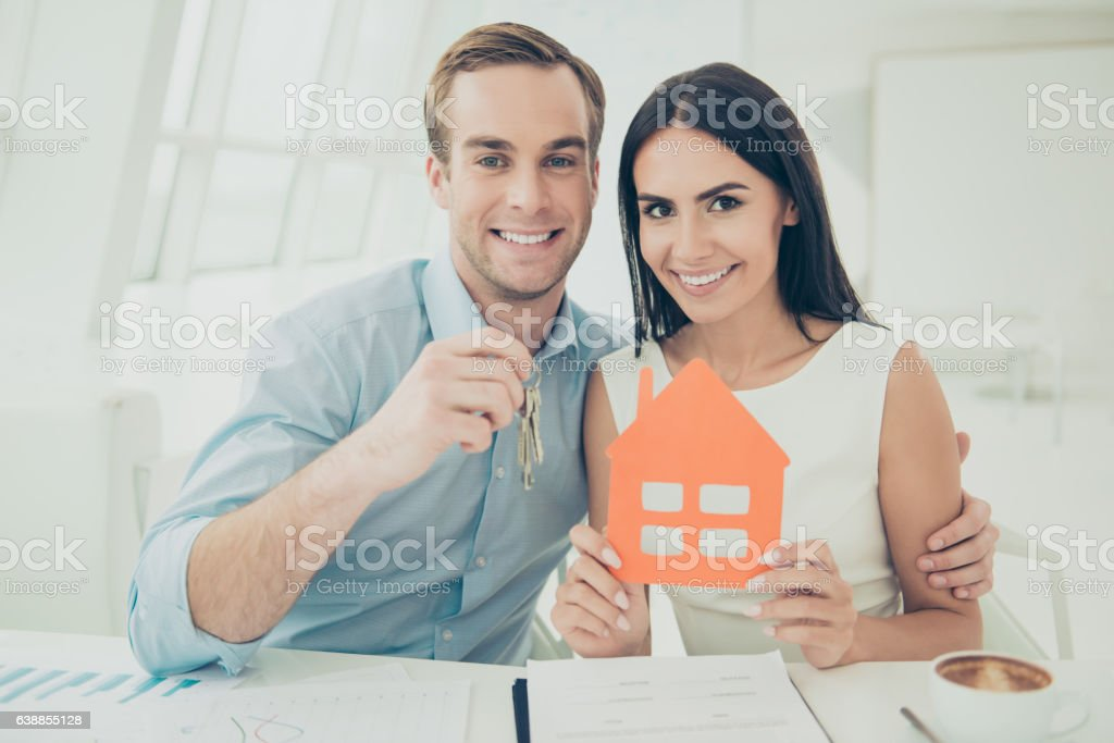 Portrait of happy young family buying new house stock photo