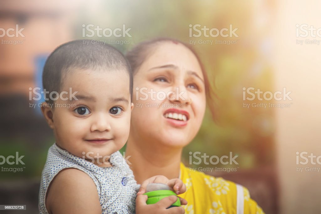 Portrait Of Happy Young Indian Mother And Baby Girl Outdoors Stock
