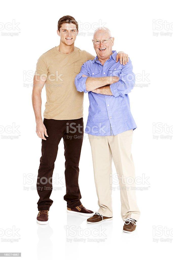 Portrait of happy young man standing con su padre - foto de stock