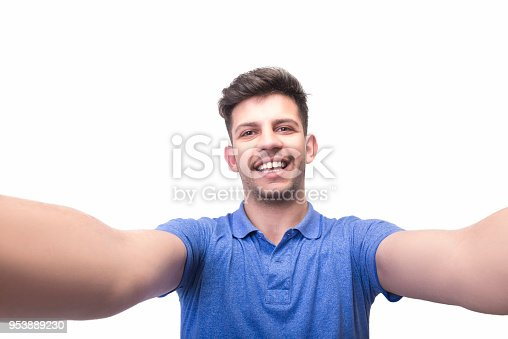 Portrait of happy young man taking a selfie on a white background. Horizontal composition. Studio shot.