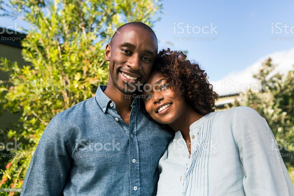 Portrait of happy young man with woman in yard stock photo