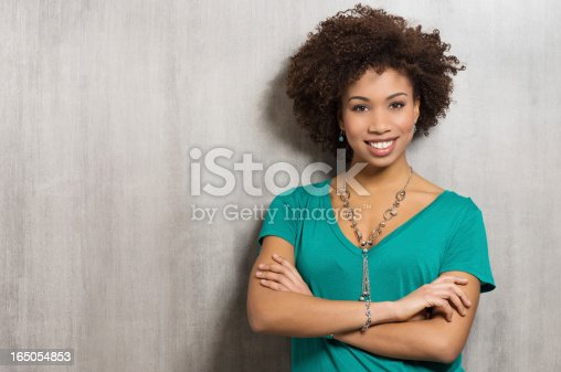 istock Portrait Of Happy Young Woman 165054853