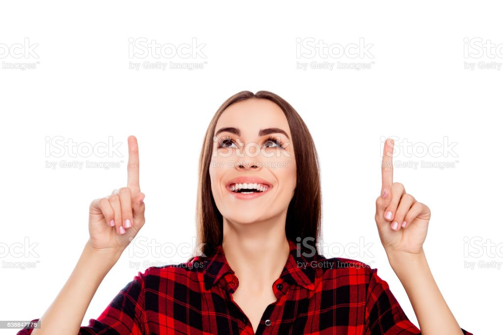 Portrait of happy young woman showing up direction stock photo